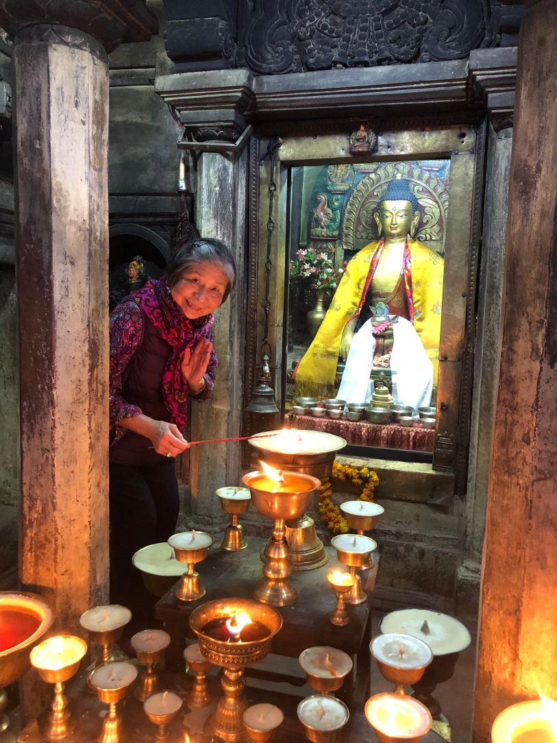 4. Lighting Butter Lamps at Mahabuddha Temple